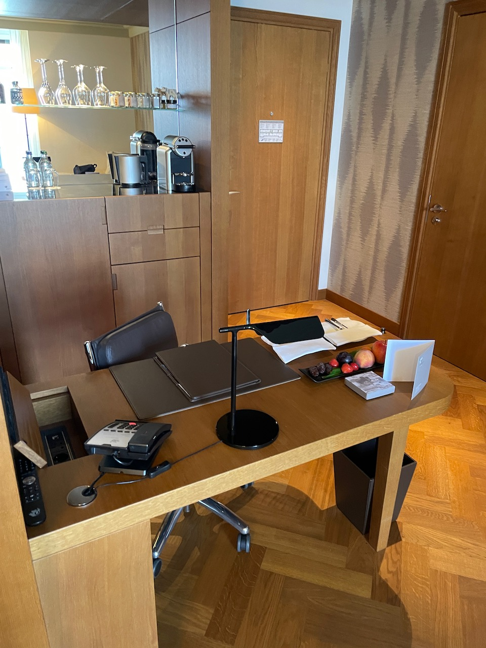 Very functional desk with USB ports and Swiss power jack. Behind is the minibar. Even though you pay over $1,600 a night, only a few items are included.