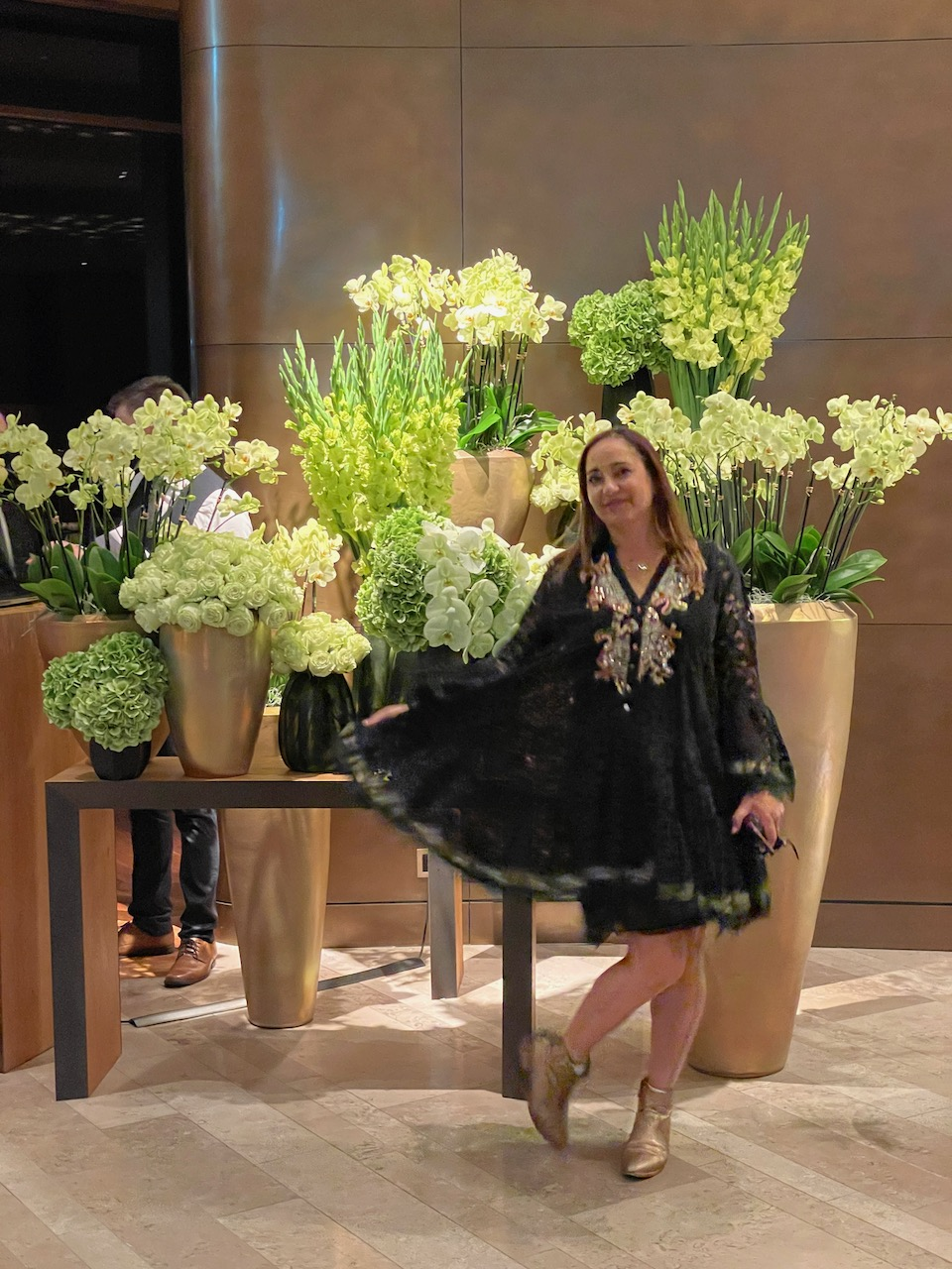 My friend taking a photo with the wonderful bouquets of flowers in the main lobby